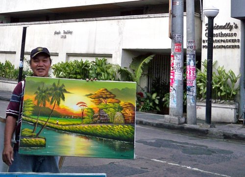Selling paintings near guesthouse entrance