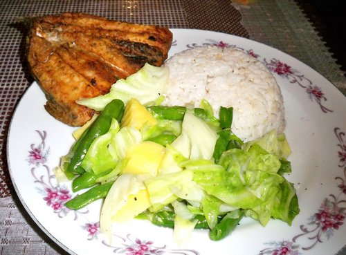fish dinner with rice and vegetables