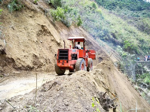 repairing the road between Bontoc and Banaue