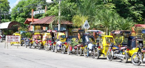 filipino tricycles waiting