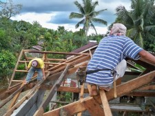 putting the roof on a new house in the Philippines