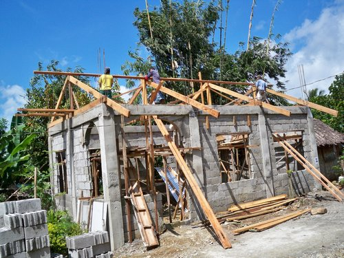 tin roof on concrete block house
