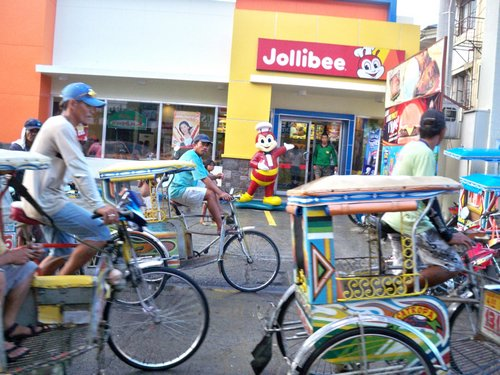 Tricycles pass by Jolibees in Catbalogan