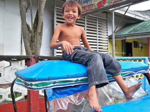 happy kid on roof